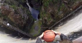 Throwing A Basketball Over The Edge Of A Giant Dam