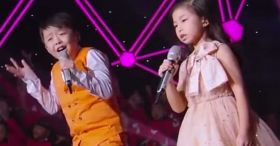 He starts 'You Raise Me Up,' but the crowd erupts when she hits her first note