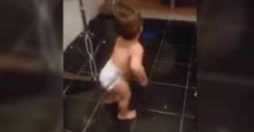 A baby gets down in the kitchen - yes, this baby can DANCE!