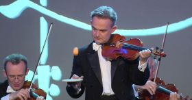 This group of violinists clearly knows how to impress a woman